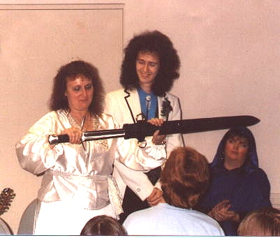 Misty, Larry and Need at Dreamcon 6 in Everett, Washington.  See the QO newsletter for November 1991 for coverage of the event.